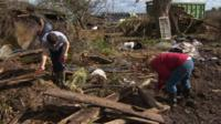 Young farmers help clear up flood damage