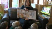 Elys Dolan reading to children