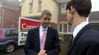 BBC West Business correspondent Dave Harvey (l) outside a home for sale