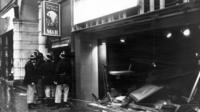 Firemen outside the bombed Tavern in the Town in Birmingham in 1974