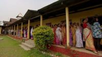 Voters in Assam queuing outside polling station