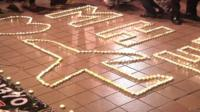 Candles form the image of a plane in Kuala Lumpur
