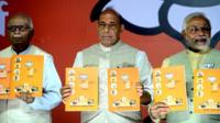 "India""s Bharatiya Janata Party (BJP) Prime Ministerial candidate Narendra Modi poses with the party manifesto"