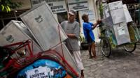 Pedicab drivers load up ballot boxes