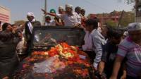 Arvind Kejriwal in car at rally