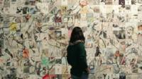 A visitor looking at an artwork in the Istanbul Modern museum