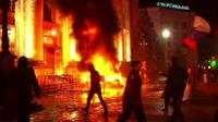 Burning building amid protests