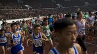 Runners take off inside Kim Il Sung Stadium