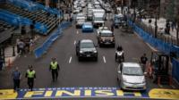 Police officers patrol the finish line of the Boston Marathon, on April 14, 2014 in Boston