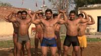 Men showing their muscles