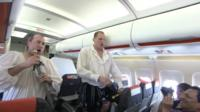 Actors performing on plane