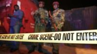 Security forces secure the scene around a vehicle explosion outside a police station in central Nairobi,