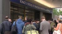 Commuters queuing outside Kings Cross tube station