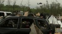 A helicopter in the background of aftermath from the tornado