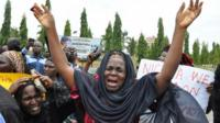 An unidentified mother cries out during a demonstration with others who have daughters among the kidnapped school girls of government secondary school Chibok, Tuesday April 29, 2014