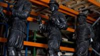 Statues in warehouse