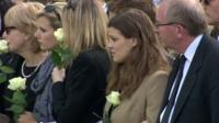 Mourners watching a cortege