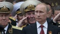 Russian President Vladimir Putin attends a parade marking the Victory Day in Sevastopol, Crimea