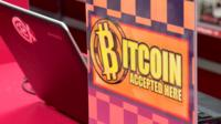 A 'bitcoin accepted here' sign
