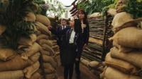 Visitors looking around a World War One themed garden at Chelsea Flower Show