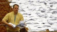 European Parliamentary election ballot papers, from the local area, are sorted as part of the count, in Southampton
