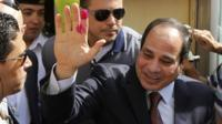 Abdel Fattah al-Sisi gestures after casting his ballot in Cairo, Egypt, 26 May 2014