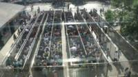 Commuters are queuing at a subway station in Chinese capital Beijing
