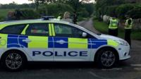 Police car near scene of the incident