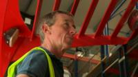 Man operating forklift truck