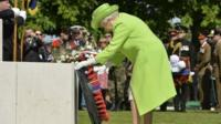 The Queen lays a wreath at Bayeux War Cemetery