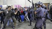 Subway train operators, along with some activists, clash with police at the Ana Rosa metro station on the second day of their metro strike in Sao Paulo