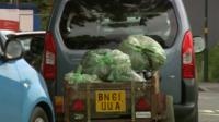 Car with rubbish in a trailer