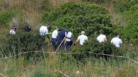 Police searching scrubland