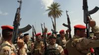 Iraqi army troops chant slogans against the Islamic State of Iraq and the Levant