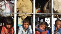 Pakistani children arrive by truck with some belongings in the neighborhood of Bannu, after fleeing North Waziristan tribal region in northwestern Pakistan