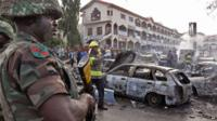 Nigerian soldier at scene of explosion
