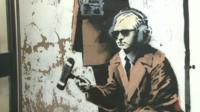 Section of Banksy work showing man with microphone and headphones
