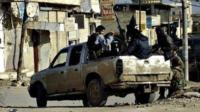 Undated photo showing members of the the Islamic State in Iraq and the Levant (ISIS) in Raqqa (14 January 2014)