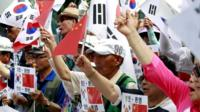 Conservative activists stage a rally welcoming Chinese President Xi Jinping's visit to South Korea, near the Chinese Embassy in Seoul, South Korea