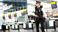 Armed police officers patrol the new Terminal 5 at Heathrow Airport