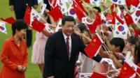 South Korean president Park Geun-hye and Chinese president Xi Jinping greet children in Seoul