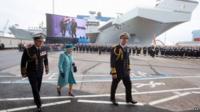 Queen Elizabeth II and the Duke of Edinbugh and HMS Queen Elizabeth