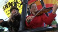 Violinists in a hot air balloon