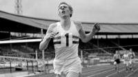 Roger Bannister crosses the line at the Vancouver Games