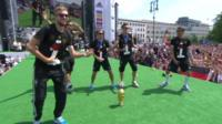 German football players celebrate on stage