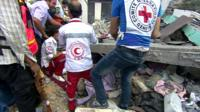 Rescuers pull woman from rubble