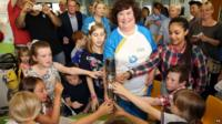 Susan Boyle carries the Glasgow 2014 Queen's Baton to Yorkhill Hospital in Glasgow