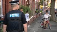 Police officer on patrol in Oldham