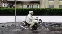 Man on motorcycle in Worthing flash flooding