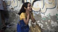 A Palestinian girl reacts at the scene of an explosion that medics said killed eight children and two adults
